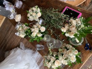 Bouquets of white roses before the ceremony begins