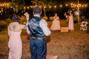 Play cornhole at a garden wedding